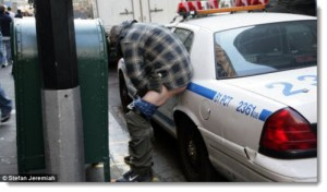 occupy wall street man pooping on police car oct 2011 300x176 The Top 50 Liberal Media Bias Examples