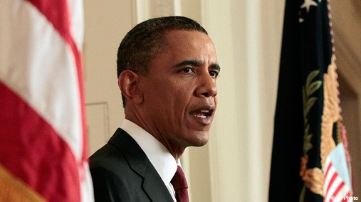 Barack Obama between flags SC State of the Union: Mammoth Government is the New Normal