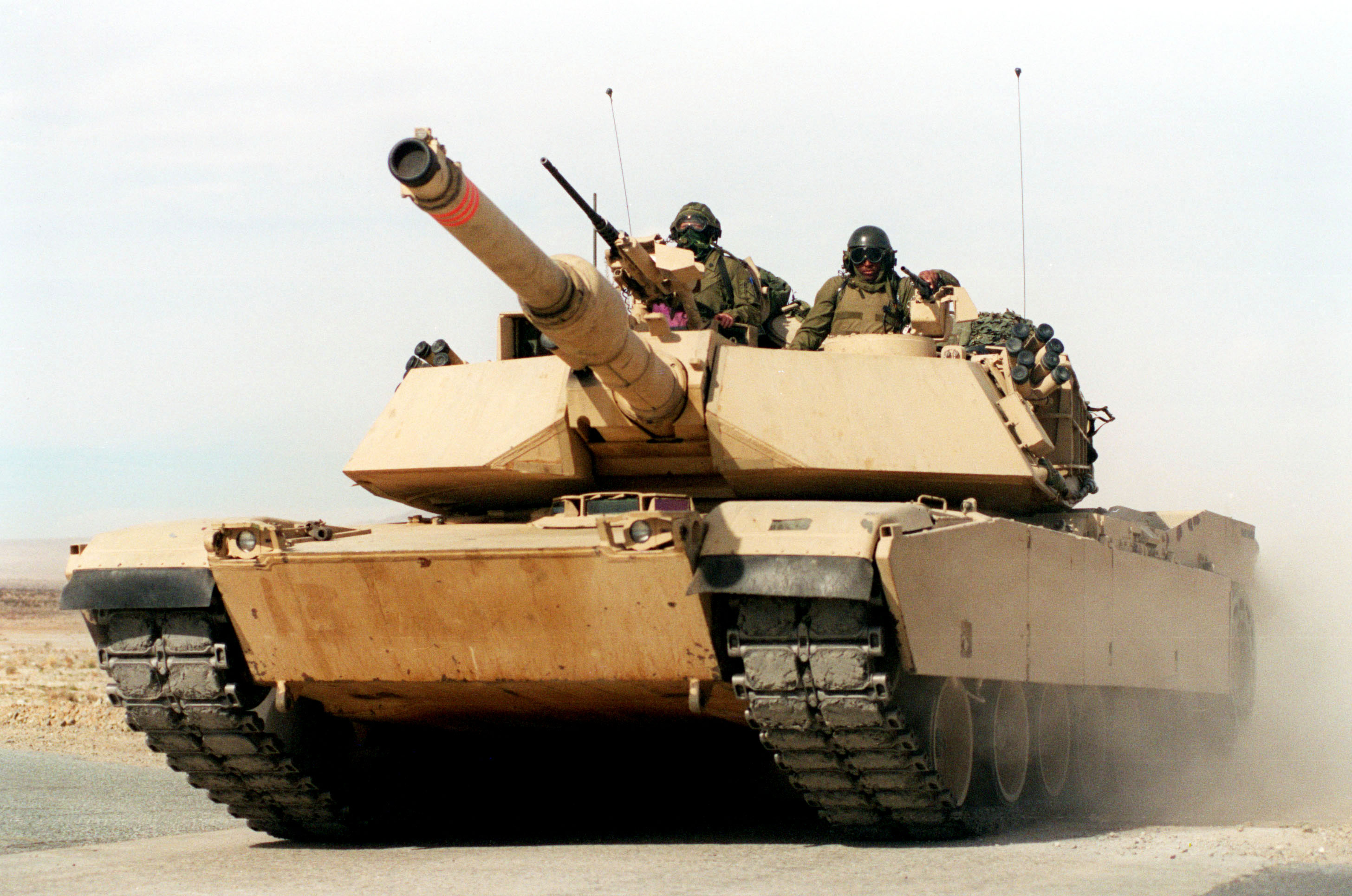 A U.S. Marine Corps M-1A1 Abrams main battle tank races across the desert at the Marine Corps Air Ground Combat Center, Twentynine Palms, Calif., on Jan. 27, 1998. These tankers from the 2nd Tank Battalion are taking part in Combined Arms Exercise 3-98. DoD photo by Lance Cpl. W. Makela, U.S. Marine Corps.