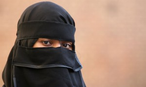 Woman in muslim attire Lo 007 300x180 Student to violate No Hat policy as long as Muslims can wear hijab