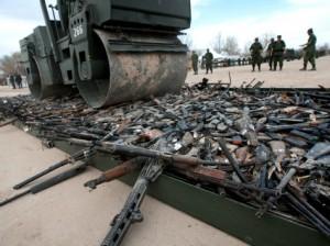 guns_bulldozed_AFP