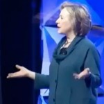 Hillary dodges shoe