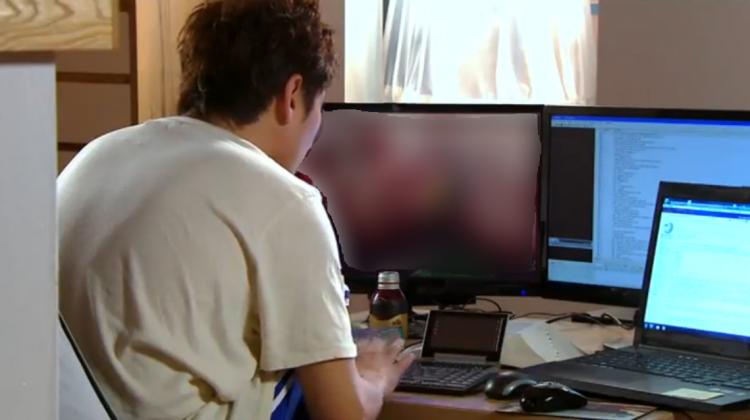 guy looking at computer SC