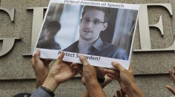 Protesters supporting Snowden hold a photo of him during a demonstration outside the U.S. Consulate in Hong Kong