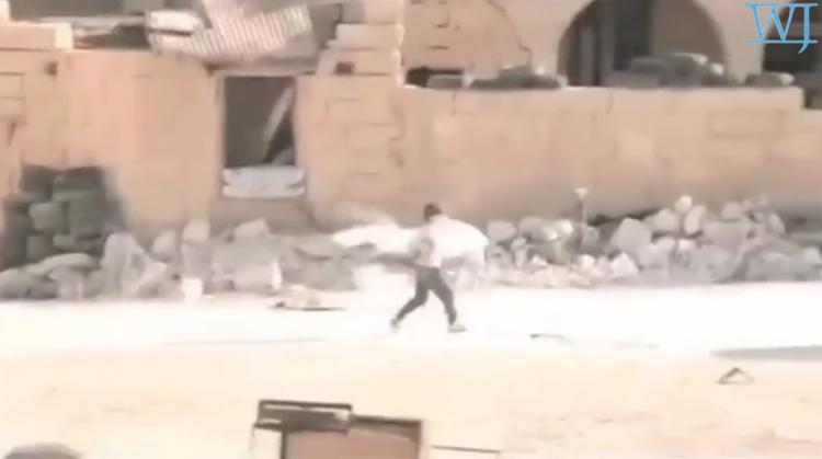 Syrian Boy taking shot to chest