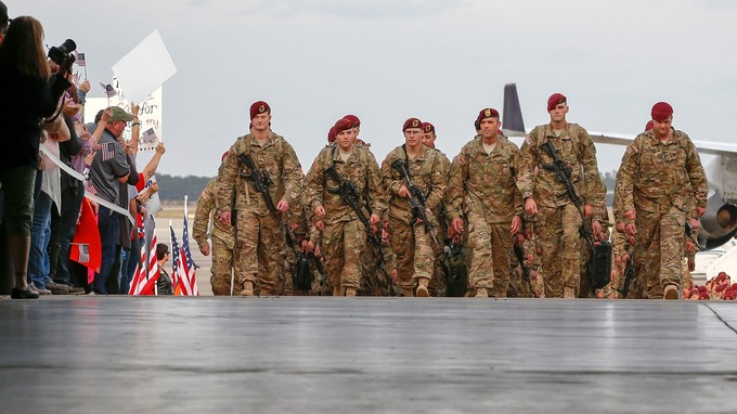 Paratroopers with the 1st Brigade Combat Team, 82nd Airborne Division, march up the ramp as they return home. Credit: Reuters