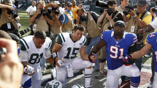 EAST RUTHERFORD, NJ - SEPTEMBER 09:  Tim Tebow #15 and Dustin Keller #81 of the New York Jets pray with teammates and members of the Buffalo Bills after their season opener at MetLife Stadium on September 9, 2012 in East Rutherford, New Jersey.  (Photo by Jeff Zelevansky/Getty Images)