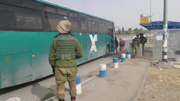 IDF soldiers guard a bus stop at Gush Etzion intersection