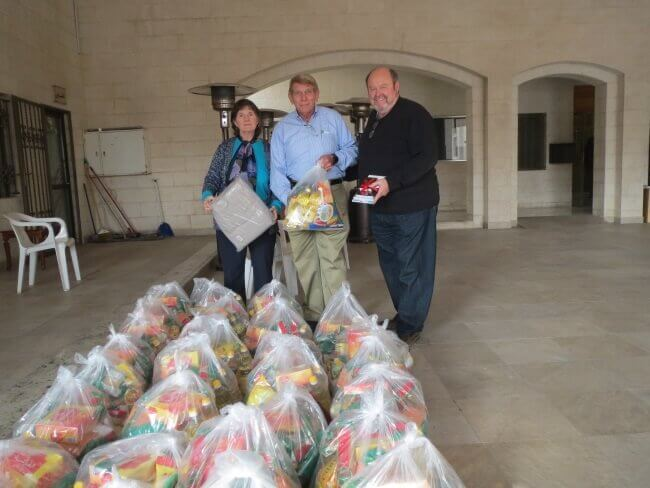 Image Credit: Christmas for Refugees - Family gift bags with food staples and a blanket - Nancy and William Murray and Bob Armstrong