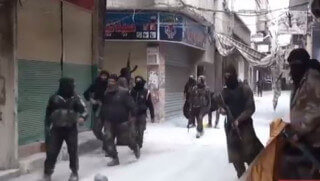 Image credit: YouTube Islamic State group fighters near Damascus, Syria, in April.