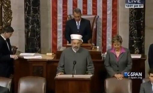 Speaker Boehner bows head as Imam Chebli delivers prayer.
