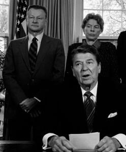 Brzezinski standing behind Reagan, circa 1985.