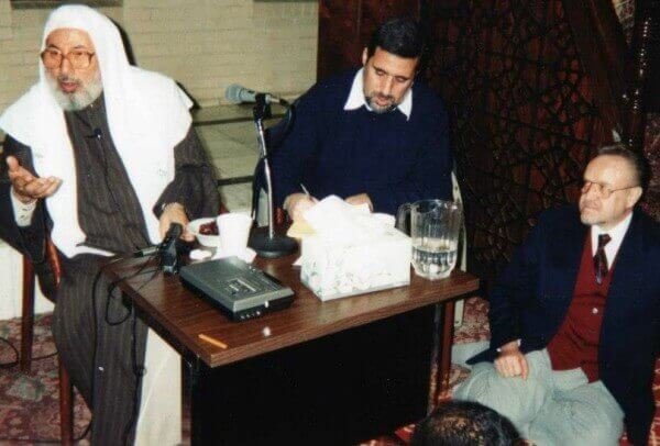 Qaradawi at Dar al-Hijrah mosque (far left) and Estwani (on floor)