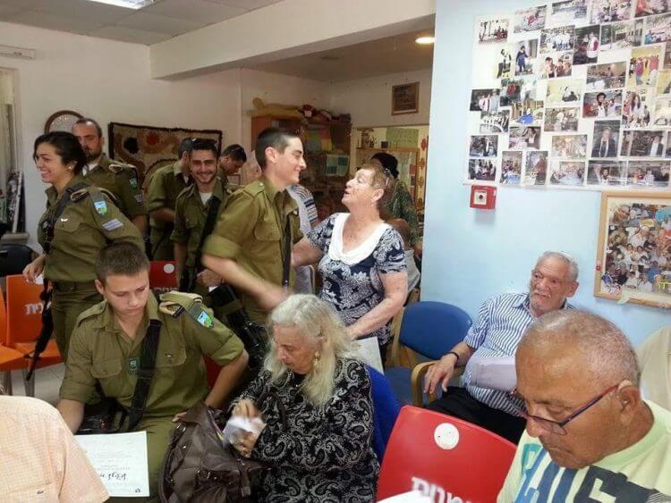 IDF Soldiers during a visit to Holocaust survivors at Kibbutz Ginosar - Photo Tzipi Shamir