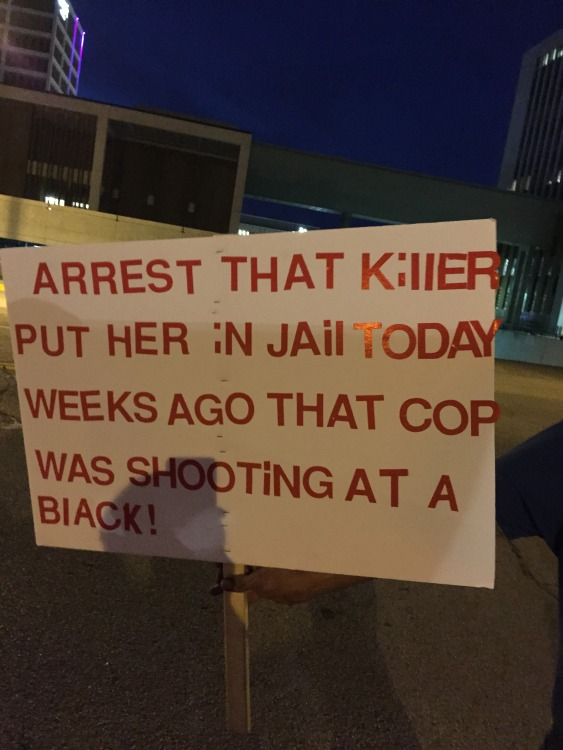 A protestor holds a sign calling for the arrest of officer Betty Shelby in Downtown Tulsa, OK.