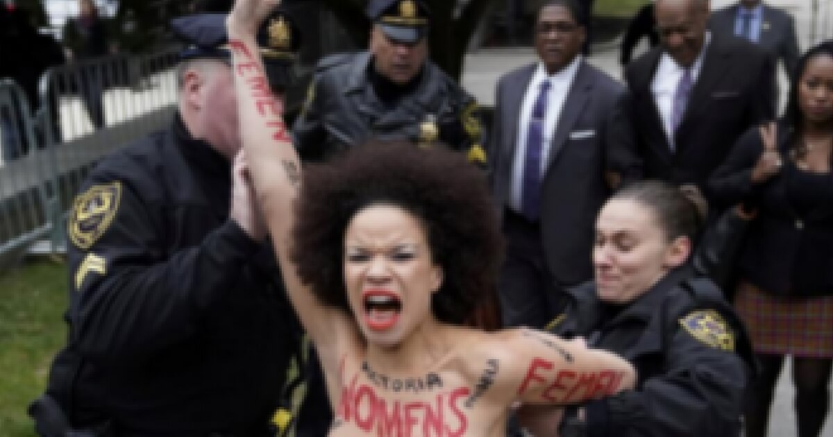 Topless protester at Bill Cosby retrial identified as