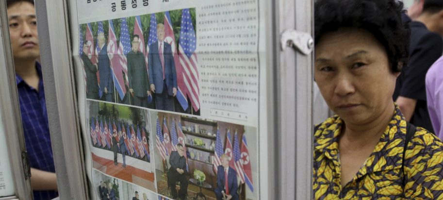 "In this Wednesday, June 13, 2018, photo, people read a newspaper dominated with news on the summit between U.S. President Donald Trump and North Korean leader Kim Jong Un at a subway station in Pyongyang, North Korea. North Koreans are getting a new look at U.S. President Donald Trump now that his summit with leader Kim Jong Un is safely over and it's a far cry from the ""dotard"" label Pyongyang slapped on him last year."