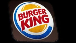 An illuminated Burger King sign is seen on Aug. 25, 2014 in Washington, D.C.