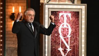 Actor Robert De Niro holds his fists in the air as he gives profanity-laden anti-Trump speech at the 2018 Tony Awards