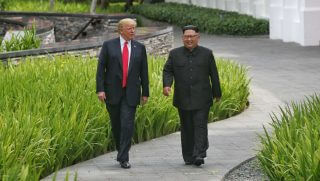 SINGAPORE, SINGAPORE - JUNE 12: In this handout photograph provided by The Strait Times, U.S. President Donald Trump (L) with North Korean leader Kim Jong-un (R) with during their historic U.S.-DPRK summit at the Capella Hotel on Sentosa island on June 12, 2018 in Singapore. U.S. President Trump and North Korean leader Kim Jong-un held the historic meeting between leaders of both countries on Tuesday morning in Singapore, carrying hopes to end decades of hostility and the threat of North Korea's nuclear programme.
