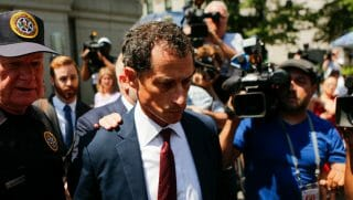 Former Democrat Congressman Anthony Weiner (C) exits federal court in Manhattan after pleading guilty in sexting case on May 19, 2017 in New York City. Weiner, who resigned from Congress over a sexting scandal, pleaded guilty to federal charges of transmitting sexual material to a minor.
