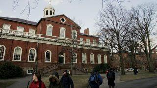 Students walk through Harvard campus.
