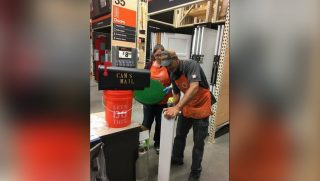 Home Depot employees constructing a mailbox for 7-year-old Cameron.