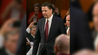 Former FBI Director James Comey arrives to testify during a US Senate Select Committee on Intelligence hearing on Capitol Hill in Washington,DC, June 8, 2017.