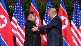 SINGAPORE - JUNE 12: In this handout photo, North Korean leader Kim Jong-un (L) shakes hands with U.S. President Donald Trump during their historic U.S.-DPRK summit at the Capella Hotel on Sentosa island on June 12, 2018 in Singapore. U.S. President Trump and North Korean leader Kim Jong-un held the historic meeting between leaders of both countries on Tuesday morning in Singapore, carrying hopes to end decades of hostility and the threat of North Korea's nuclear program.