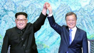 North Korean leader Kim Jong Un (L) and South Korean President Moon Jae-in (R) pose for photographs after signing the Panmunjom Declaration for Peace, Prosperity and Unification of the Korean Peninsula during the Inter-Korean Summit at the Peace House on April 27, 2018 in Panmunjom, South Korea.