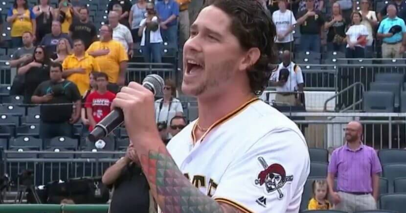 Pirates relief pitcher Steven Brault sings the national anthem at PNC Park.