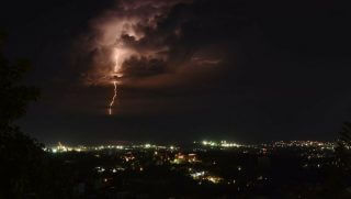 Lightning strikes over over the sea on the coast of the Haitian capital, Port-au-Prince, during an early morning thunderstorm.