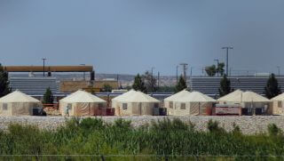 View of a temporary detention centre for illegal underage immigrants in Tornillo, Texas, US near the Mexico-US border, as seen from Valle de Juarez, in Chihuahua state, Mexico on June 18, 2018. - Mexico strongly condemned US President Donald Trump's administration Tuesday for its policy of separating immigrant children and parents detained after crossing the US-Mexican border, calling it 'inhuman.'