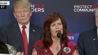 angel mom speaking at podium with Trump behind her