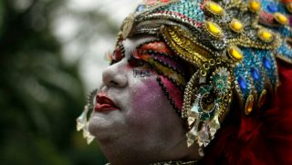 Drag queen wearing headdress