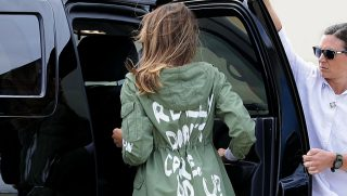 "Melania Trump gets into car wearing ""I don't really care"" jacket"
