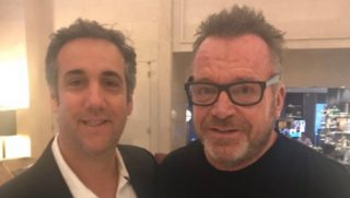 Former Trump attorney Michael Cohen posing with actor Tom Arnold