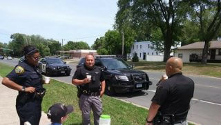 Police officers save a little boy's lemonade stand.