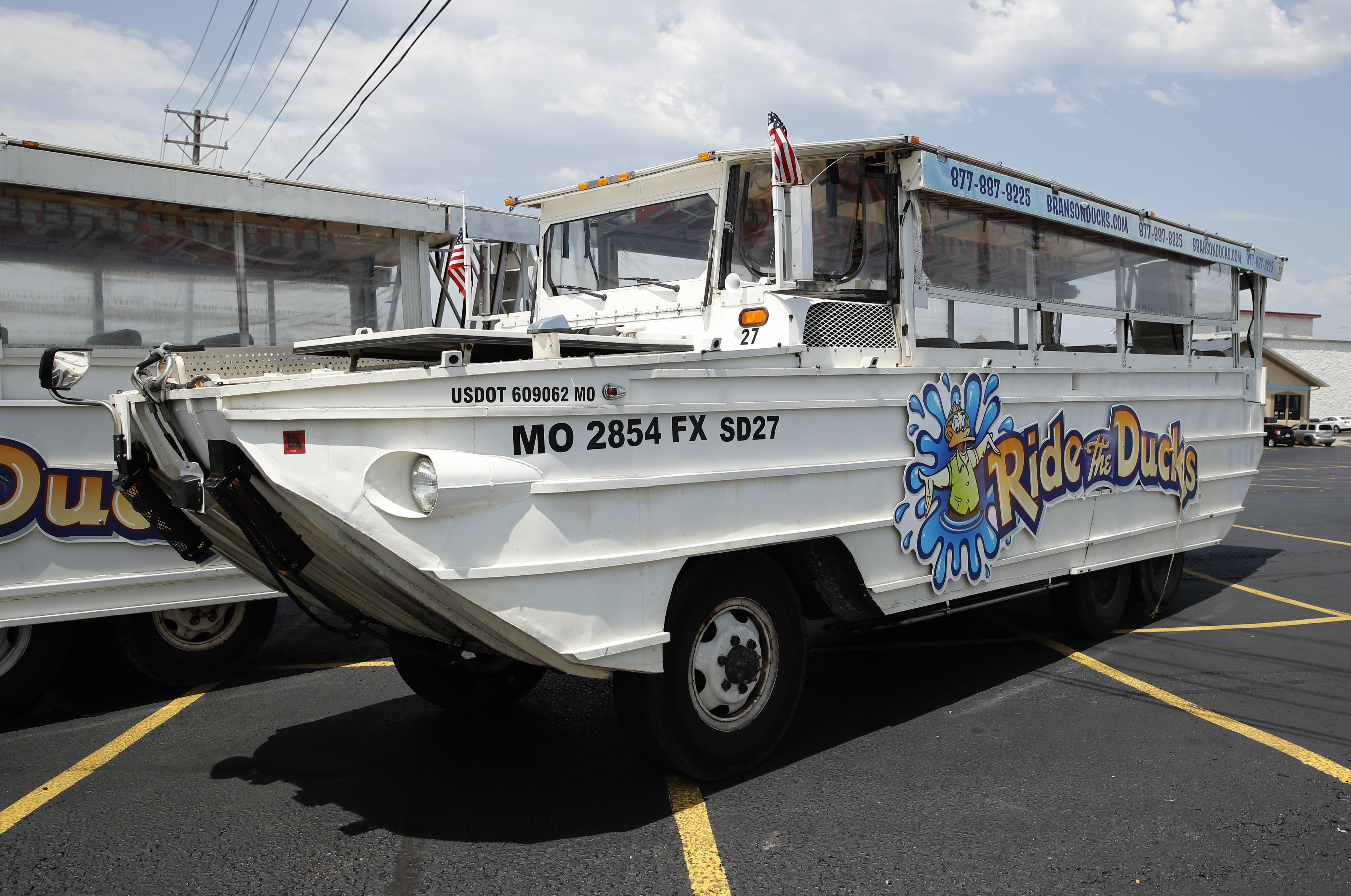 FILE - In this July 20, 2018, file photo, a duck boat sits idle in the parking lot of Ride the Ducks, an amphibious tour operator in Branson, Mo. A lawsuit seeking $100 million in damages was filed Sunday, July 29, against the owners and operators of a duck boat that sank July 19.