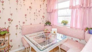 Image of a pink kitchen table and booth in a vintage Toronto home