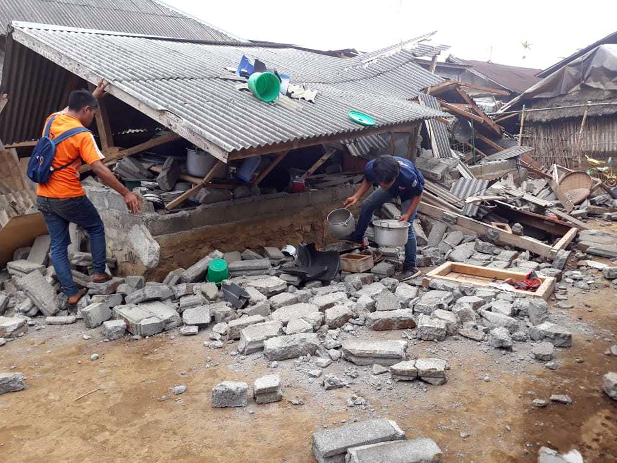 Villagers clear debris caused by an earthquake at Sajang village, Sembalun, East Lombok, Indonesia, Monday, July 30, 2018. A strong and shallow earthquake early Sunday killed more than a dozen people on Indonesia's Lombok island, a popular tourist destination next to Bali, officials said.