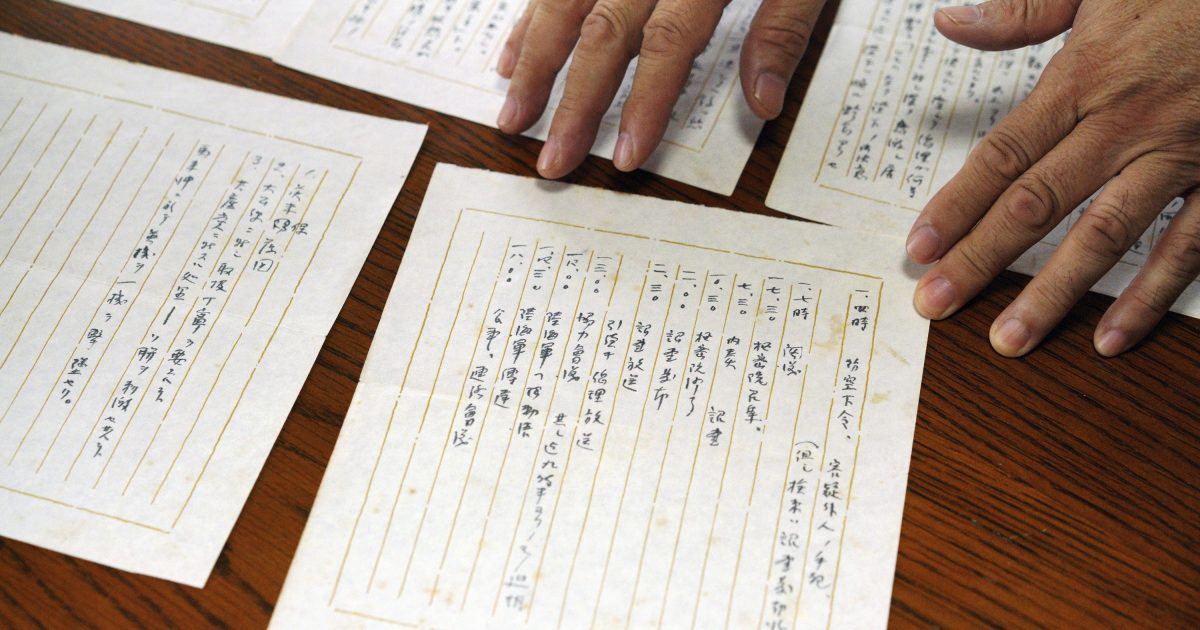 """In this July 26, 2018, photo, Takeo Hatano, a used bookstore owner, shows the five-page """"Yuzawa memo,"""" written by Michio Yuzawa, interior vice minister in 1941, in Tokyo. The newly released memo by a wartime Japanese official provides what a historian says is the first look at the thinking of Emperor Hirohito and Prime Minister Hideki Tojo on the eve of the Japanese attack on Pearl Harbor that thrust the U.S. into World War II."""