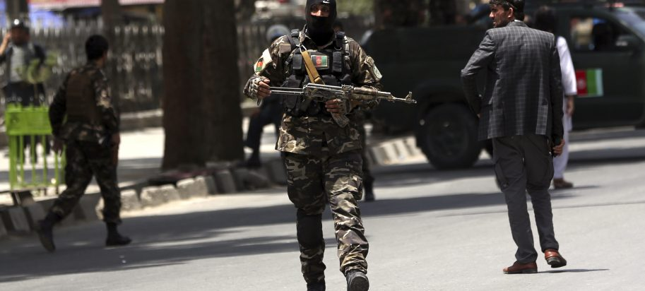 Security personnel patrol near a park where a would-be attacker was killed in Kabul, Afghanistan, Monday, July 16, 2018. A would-be suicide attacker was shot and killed by police in Kabul before he was able to get close to a gathering of supporters of the country's first vice president, Gen. Abdul Rashid Dostum, according to police spokesman Hashmat Stanekzai. Dostum is currently in Turkey.