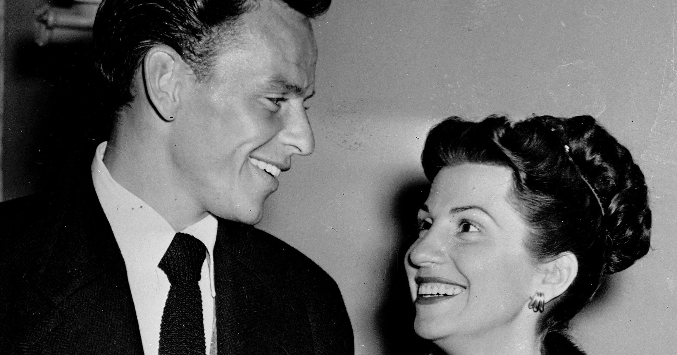In this Oct. 23, 1946 file photo, singer Frank Sinatra and his wife Nancy smile broadly as they leave a Hollywood night club following a surprise meeting. Nancy Sinatra Sr., the childhood sweetheart of Frank Sinatra who became the first of his four wives and the mother of his three children, has died. She was 101. Her daughter, Nancy Sinatra Jr., tweeted that her mother died Friday, July 13, 2018.