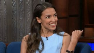 Alexandria Ocasio-Cortez holds news conference in front of the Wall Street bull