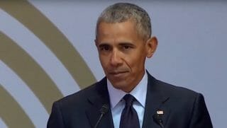 Barack Obama at a speech honoring the 100th birthday of Nelson Mandela