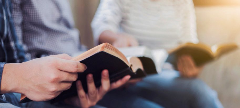 People reading and discussing the Bible