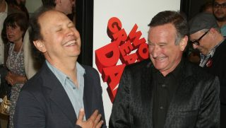 Billy Crystal and Robin Williams laughing