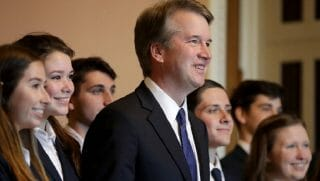 Brett Kavanaugh surrounded by young people.