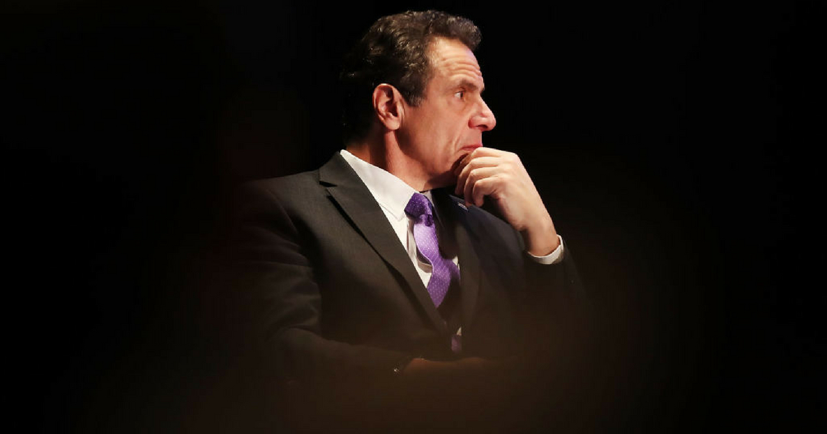 New York Governor Andrew Cuomo watches as former Vice President Al Gore speaks at an event at New York University, denouncing the Trump administration's proposal to open up new areas to offshore drilling, on March 9, 2018 in New York City.